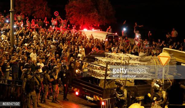 TOPSHOT Palestinians celebrate outdid the Lion's Gate entrance to Al Aqsa mosque on July 27 2017 after more Israeli barriers were removed from the...