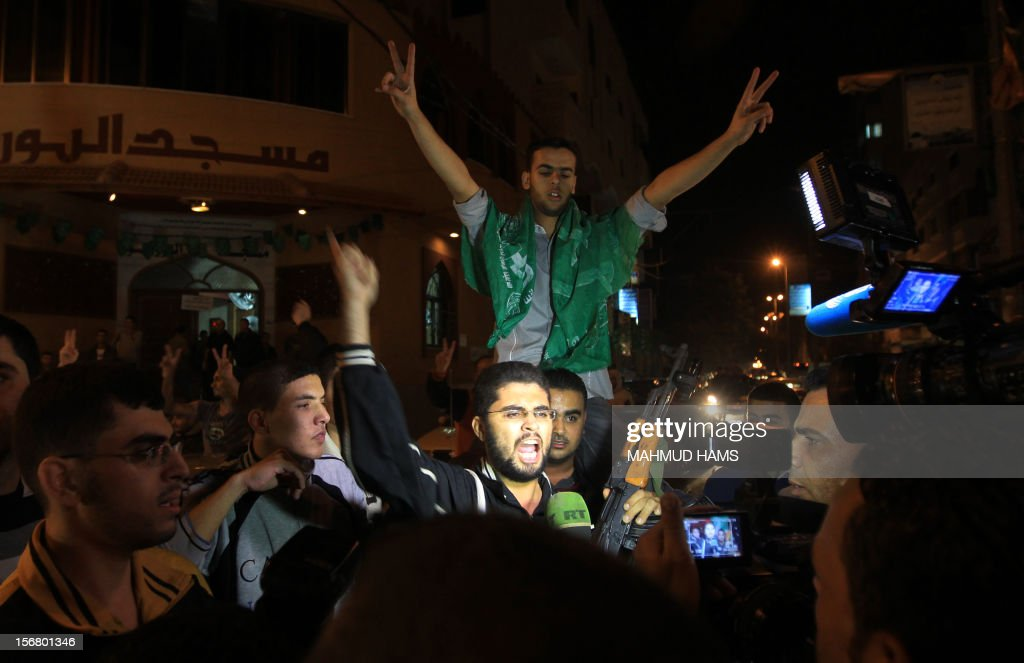 Palestinians celebrate the beginning of the truce with Israel in Gaza City on November 21, 2012. Palestinians in Gaza took to the streets to celebrate the start of a truce deal with Israel that was announced in Egypt on the eighth day of violence in and around Gaza.