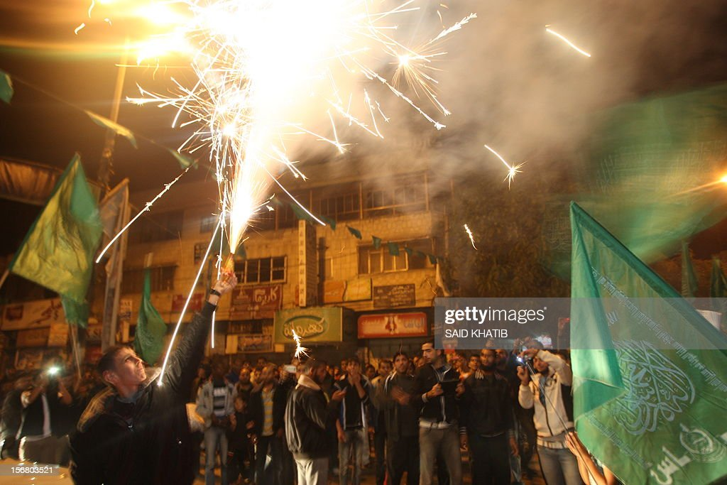 Palestinians celebrate the beginning of the truce with Israel in Rafah town in the southern Gaza Strip on November 21, 2012. Palestinians in Gaza took to the streets to celebrate the start of a truce deal with Israel that was announced in Egypt on the eighth day of violence in and around Gaza.