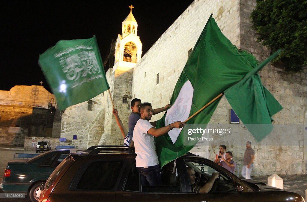 Palestinians celebrate the newly agreed cease-fire between Israel and Gaza in Bethlehem City. Palestinian President Mahmoud Abbas, announced on an Egyptian-brokered ceasefire proposal to end seven weeks of fighting between Israel and Hamas groups in the Gaza Strip.