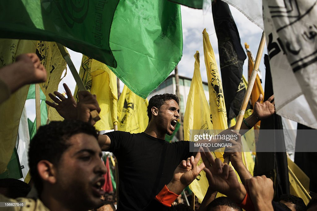 Palestinians celebrate waving Fatah and Hamas flags at the square of the Unknown Soldier in central Gaza City on November 22, 2012. Israeli politicians returned to the campaign trail as the streets of Gaza came back to life after a truce ended eight days of bloodshed, with both sides claiming victory while remaining wary.