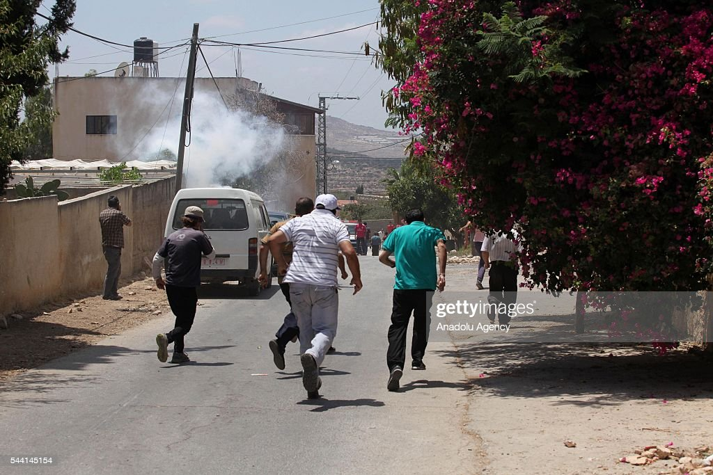 Palestinians clash with Israeli security forces during the protest against land expropriations by Israeli government at the village of Kafr Qaddum in the city of Nablus on the West Bank on July 1, 2016.