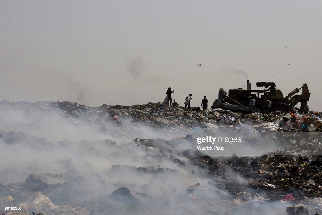 Palestinians collect plastic to be sold for recycling from a landfill March 23 2010 at the Gaza and Israel border Hamas' Ministry of Economics...