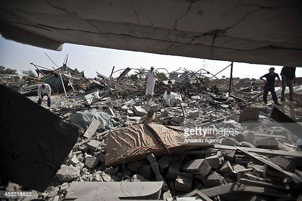 Palestinians collect their remains from the rubble of their destroyed houses during the 72hour humanitarian ceasefire in Rafah Gaza on August 05 2014...