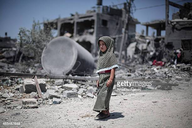 Palestinians collect their usable belongings at the debris of houses following a 72hour humanitarian ceasefire in Beit Hanoun Gaza on August 11 2014