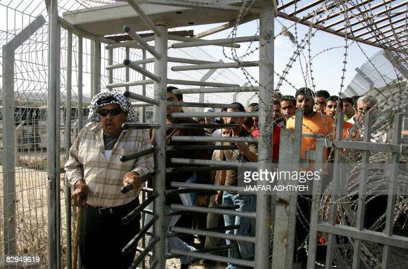 Palestinians cross the Hawara checkpoint at the southern entrance of the West Bank city of Nablus on September 22 2008 Four people were wounded today...