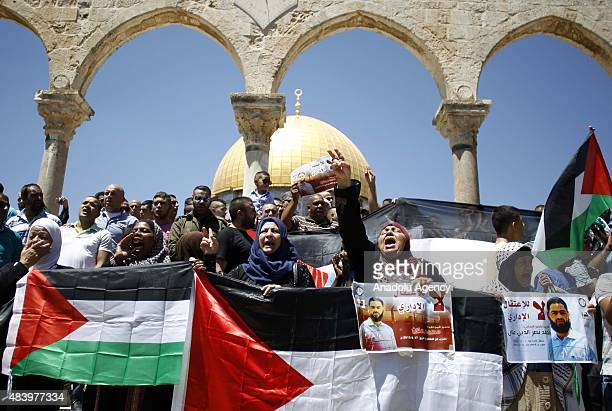 Palestinians demanding the release of Palestinian prisoners held in Israeli jails stage a demonstration following the Friday prayer in front of the...