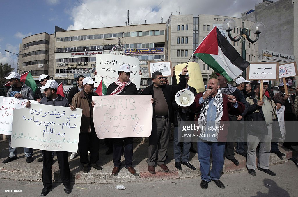 Palestinians demonstrate against the Paris Protocol and the Oslo Agreement, both key accords which govern economic ties between Palestinians and Israelis, and ask for the boycott of Israeli products in Nablus in the occupied West Bank on December 16, 2012.