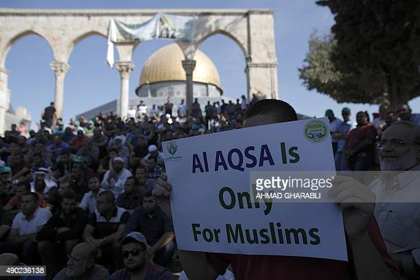 Palestinians demonstrate in front of the Dome of the Rock after clashes between Palestinian stone throwers and Israeli forces at Jerusalem's AlAqsa...