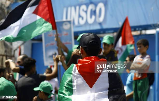 Palestinians demonstrate next to the offices of UNSCO against Israel's siege of the Gaza Strip and in solidarity with Muslims boycotting prayers at...