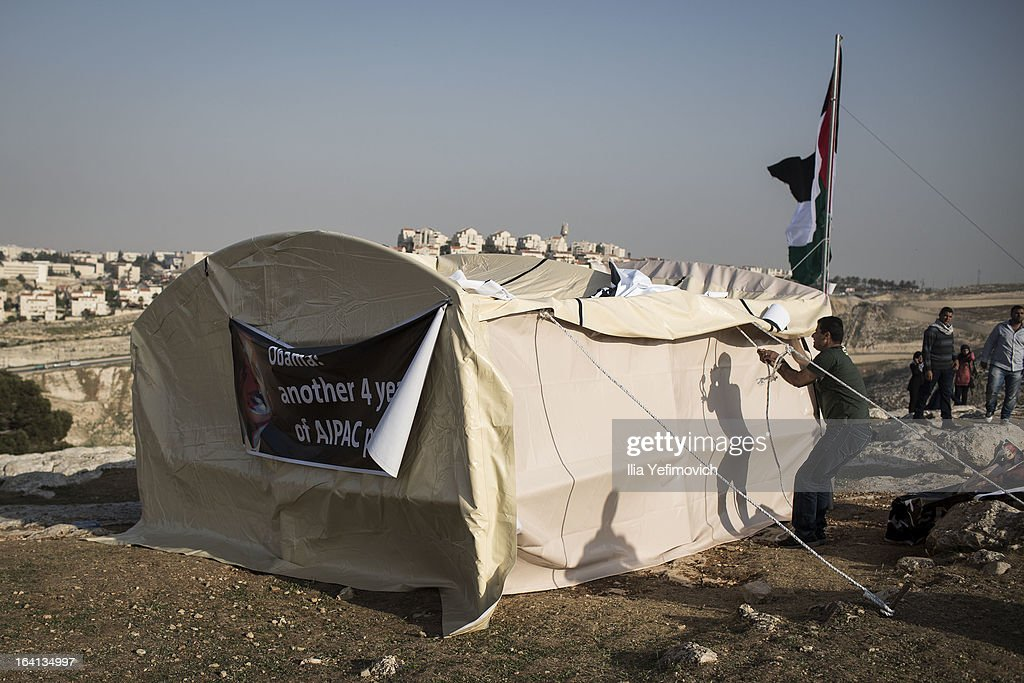 MA'ALE, ADUMIM, WEST-BANK - MARCH 20: Palestinians erect protest tents in a camp on March 20, 2013 in the E1 area next to Ma'ale Adumim. The action took place at the same time as U.S. President Barack Obama arrived to Ben Gurion airport near Tel Aviv. This will be Obama's first visit as President to the region, and his itinerary will include meetings with the Palestinian and Israeli leaders as well as a visit to the Church of the Nativity in Bethlehem.