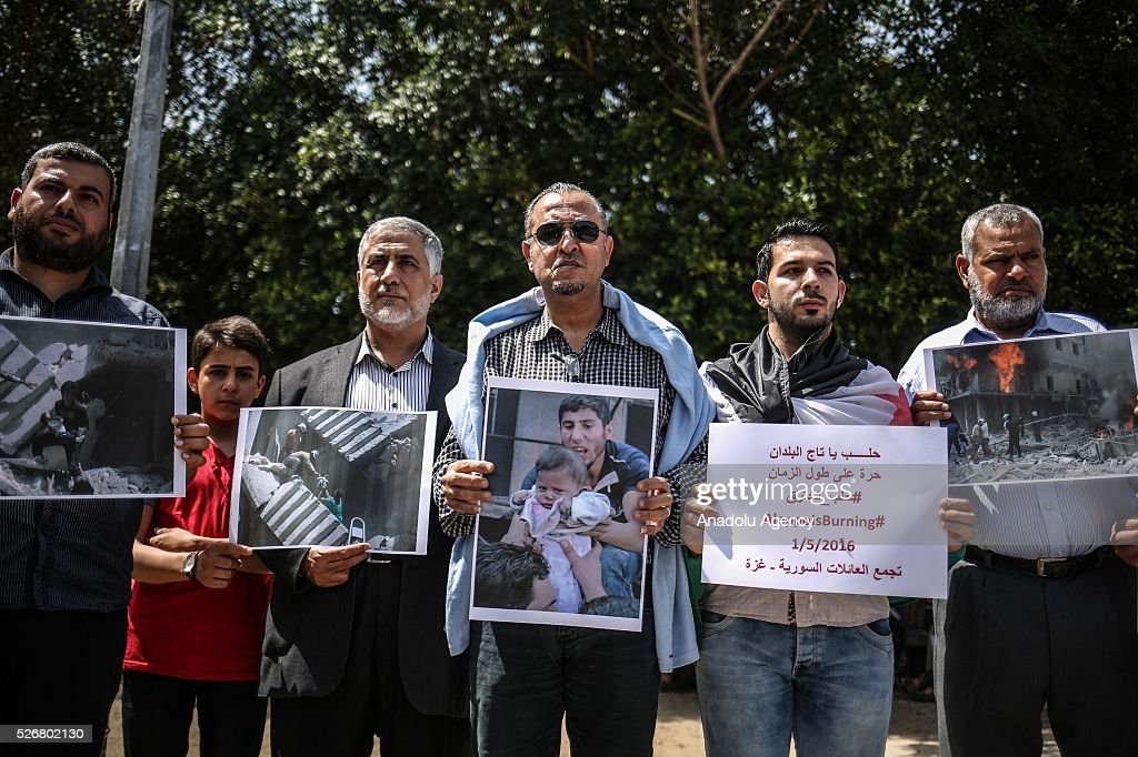 Palestinians, fled from civil war as they has been staying as refugees in Syria, stage a protest against Russian and Asad Regime's airstrikes over Aleppo during a demonstration named 'Allepo is burning' at Unknown Soldier Square in Gaza City, Gaza on May 01, 2016.