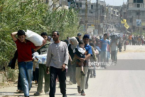 Palestinians flee from inside the Palestinian refugee camp of Nahr alBared May 23 in Tripoli Lebanon Islamic militants that were held up in the Nahr...