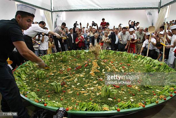 Palestinians from Ramallah hoping to make it into the Guinness Book of Records prepare what they call the biggest Tabbouleh in the world in the West...
