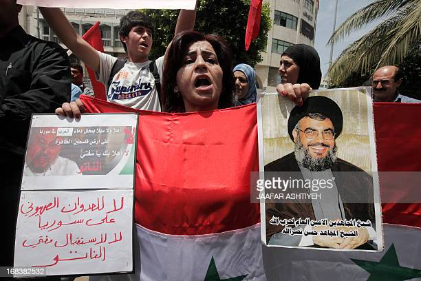 Palestinians from the Popular Front for the Liberation of Palestine hold placards during a protest against the visit of the chairman of the...