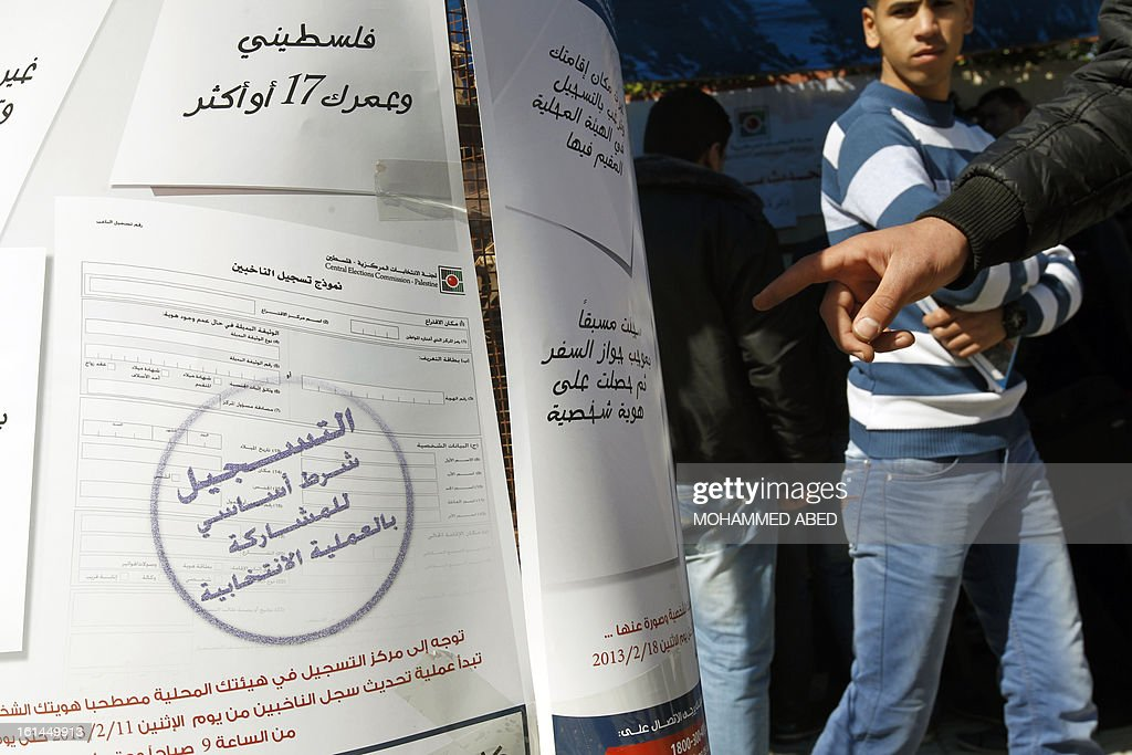 Palestinians gather outside a Central Election Commission office in Gaza City on February 11, 2013. Palestinian electoral officials began the long-overdue process of updating voter rolls in the West Bank and Gaza in a vital step towards eventual elections.