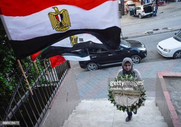 Palestinians gather to condemn two church bombings in Egypt that killed at least 43 people and injured scores in Gaza City Gaza on April 10 2017