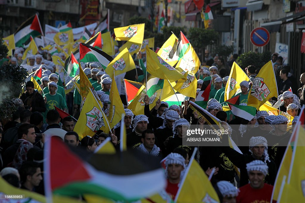 Palestinians gather to hear Palestinian president Mahmud Abbas give a speech on the eve of the 48th anniversary of the formation on the Fatah movement, on December 31, 2012, in the West Bank city of Ramallah. The Fatah anniversary commemorates the first operation against Israel claimed by its armed wing then known as Al-Assifa (The Thunderstorm in Arabic) on January 1, 1965. AFP PHOTO/ABBAS MOMANI