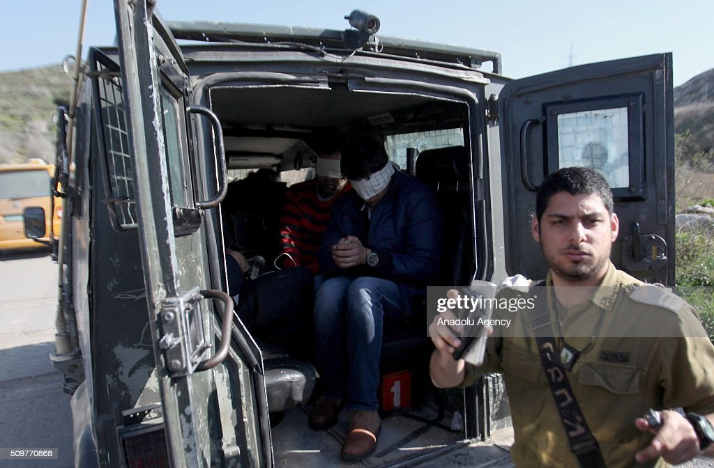 Palestinians gathered in the village of Kafr Qaddum in the city of Nablus on the West Bank are seen after they were detained by Israeli security forces during a protest against the construction of Jewish settlements and the separation wall on February 12, 2016.