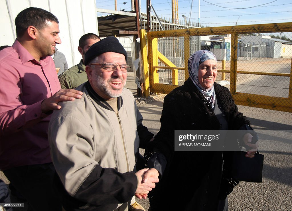 Palestinians greet and congratulate Sheikh Hassan Yousef (C), a prominent leader of the Hamas Islamic movement, following his release on January 19, 2014 after spending 28 months in Israel's Ofer prison, near the West Bank city of Ramallah. Yousef, who is also a member of the Ramallah-based Palestinian Legislative Council, told reporters after being released that he would work with Hamas rivals 'Fatah and other Palestinian factions to achieve reconciliation.'