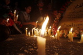 Palestinians hold a candlelight vigil in Gaza City on April 15 2011 to condemn the killing of Italian activist Vittorio Arrigoni who was killed by a...