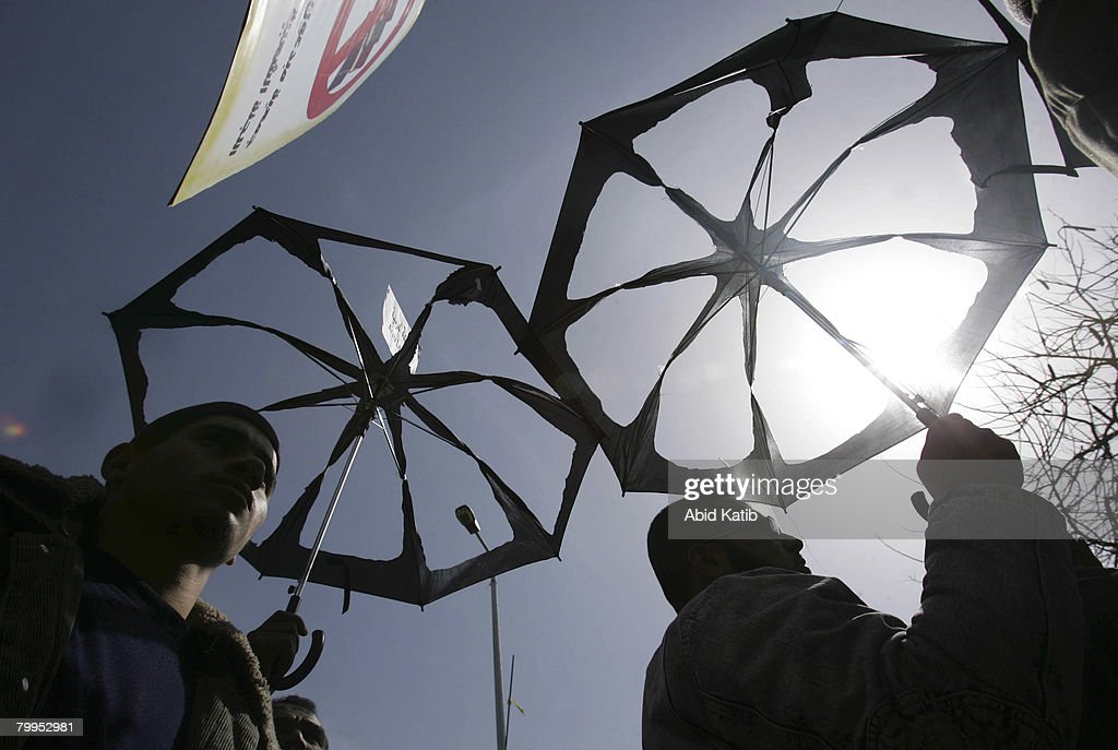 Palestinians hold aperture umbrellas as a symbolic request to protect Gaza's people, February 23, 2008 in Gaza city, Gaza Strip. Hundreds of Palestinians attended the demonstration, against the siege of Gaza, in front of the Gaza UN headquarters.