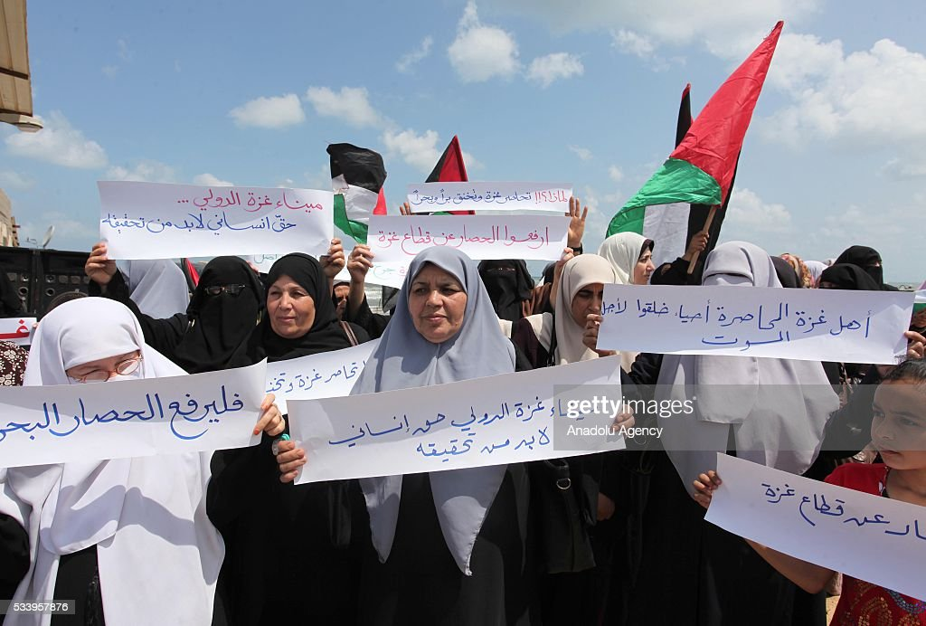 Palestinians hold banners reading 'Gaza Harbor is international' and ' Lift the Blockade' during a demonstration demanding lifting the blockade of Israel in Gaza City, Gaza on May 24, 2016.