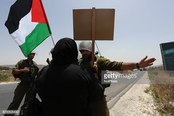 Palestinians hold national flags and pictures of children who were killed in the Israeli attack on the Gaza Strip during a march against the war in...