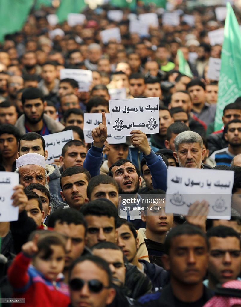 Palestinians hold placards and shout slogans praising Islam's Prophet Mohammed during a demonstration organised by Islamist movement Hamas against the cover cartoon of the Prophet published by French satirical magazine Charlie Hebdo on January 23, 2015 in Jabalia refugee camp in the northern Gaza Strip. Charlie Hebdo has printed cartoons depicting Mohammed, including one on the cover of its 'survivors' issue published after jihadist gunmen attacked its Paris offices, killing 12 people. AFP PHOTO / MOHAMMED ABED