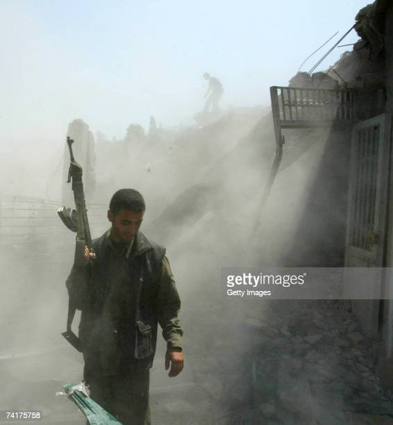 Palestinians inspect a destroyed building after an Israeli air strike May 17 2007 in Gaza City the Gaza Strip According to reports the Israeli...