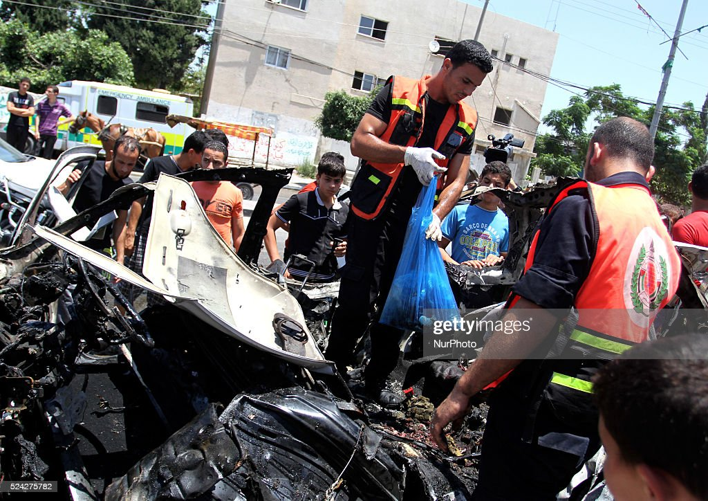 Palestinians inspect a destroyed car after an airstrike in Jabaliya northern Gaza strip on 10 July 2014 Intense Israeli airstrikes continued...