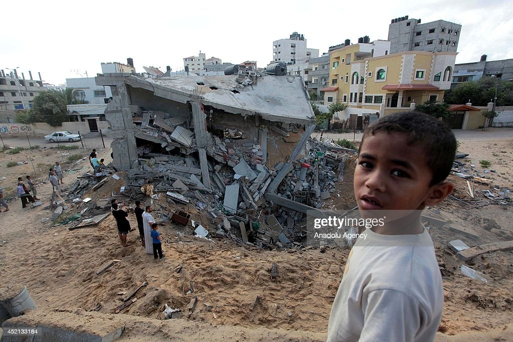 Palestinians inspect a house destroyed in air attacks staged by Israel army within the scope of 'Operation Protective Edge' in Gaza City, Gaza on July 14, 2014. At least 172 people have been killed and around 1268 injured since the start of the Israeli military operation.