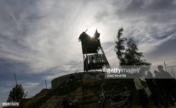 Palestinians inspect damage incurred to a Hamas post that was hit by Israeli tank and aircraft fire the previous night east of the southern Gaza...