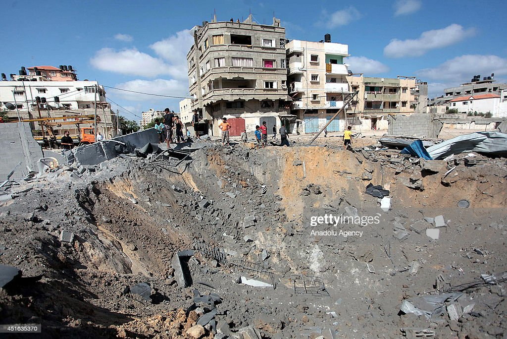 Palestinians inspect damaged areas following an overnight Israeli air strike, on July 3, 2014 in Gaza City, Gaza. At the night of July 2 Israeli air forces launched some dozen air strikes caused woundings in northern Gaza.
