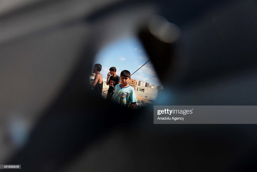 Palestinians inspect damaged areas following the Israeli air strike, on July 3, 2014 in Gaza City, Gaza. At the night of July 2 Israeli air forces launched a series of air strikes caused woundings in northern Gaza.