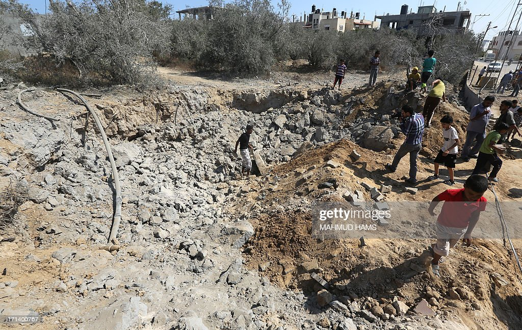 Palestinians inspect the damage following an Israeli air raid on al-Zawaida in the central Gaza strip early on June 24, 2013. The Israeli air force (IAF) attacked targets in the Gaza Strip following rocket fire from the Palestinian territory into southern Israel, sources from both sides of the conflict said.