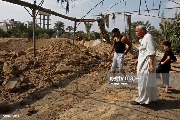 Palestinians inspect the damage of an Israeli air strike in some parts of Khan Younis in the Southern of Gaza City According to the Palestinians and...