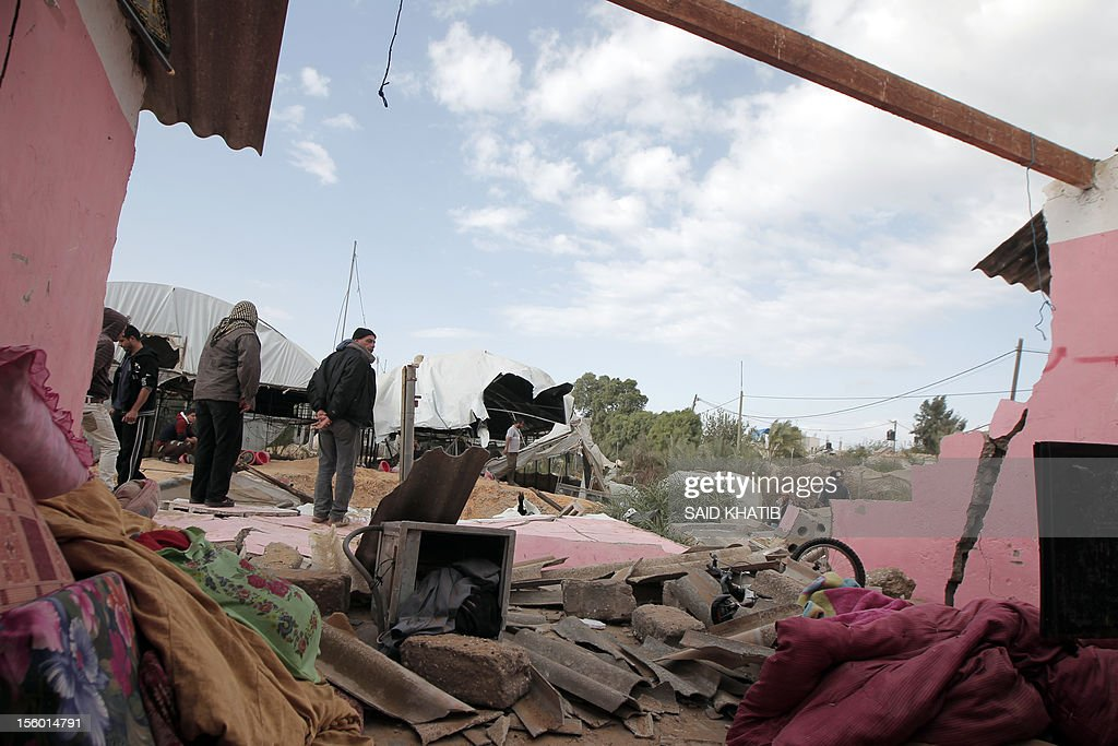 Palestinians inspect the damage to their home following an Israeli military air strike in Rafah town in the southern Gaza Strip, on November 11, 2012. The flare-up which began November 10, was one of the most serious since Israel's devastating 22-day operation in the Gaza Strip over New Year 2009, has culminated in six Palestinians being killed and 32 injured by Israeli strikes after militants fired on an Israeli jeep, wounding four soldiers, medics and witnesses said.