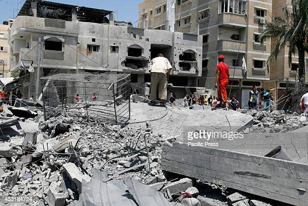Palestinians inspect the wreckage of a building which was hit in an Israeli strike in Rafah in the southern Gaza Strip Israel said it would...