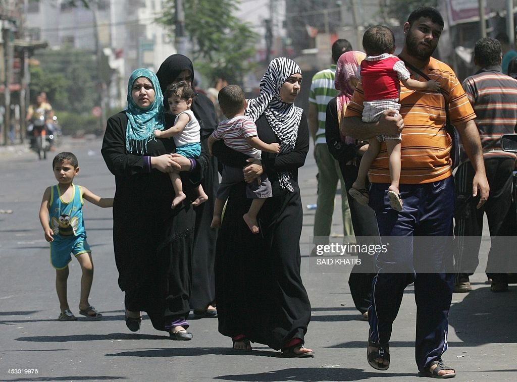 Palestinians leave their neighbourhood to head to a safer location as Israel's army continued to shell the area of Rafah, in the southern Gaza Strip, on August 1, 2014. Intensive Israeli shelling killed at least 40 people and wounded more than 150 in southern Gaza, medics said, as a fragile truce was shattered just hours after beginning.
