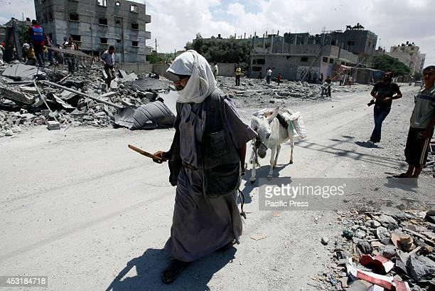Palestinians leave their neighbourhood to head to a safer location as Israel's army continued to shell the area of Rafah in the southern Gaza Strip...