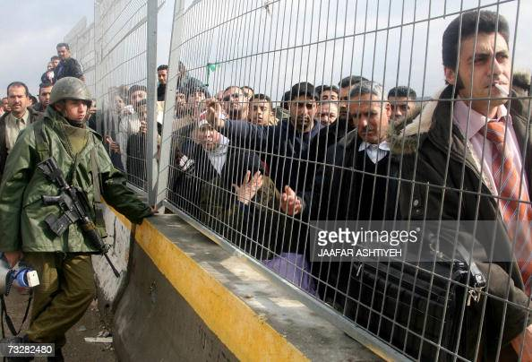 Palestinians line up at the Hawara checkpoint outside the West Bank City of Nablus after it was closed by the Israeli army who detained a Palestinian...