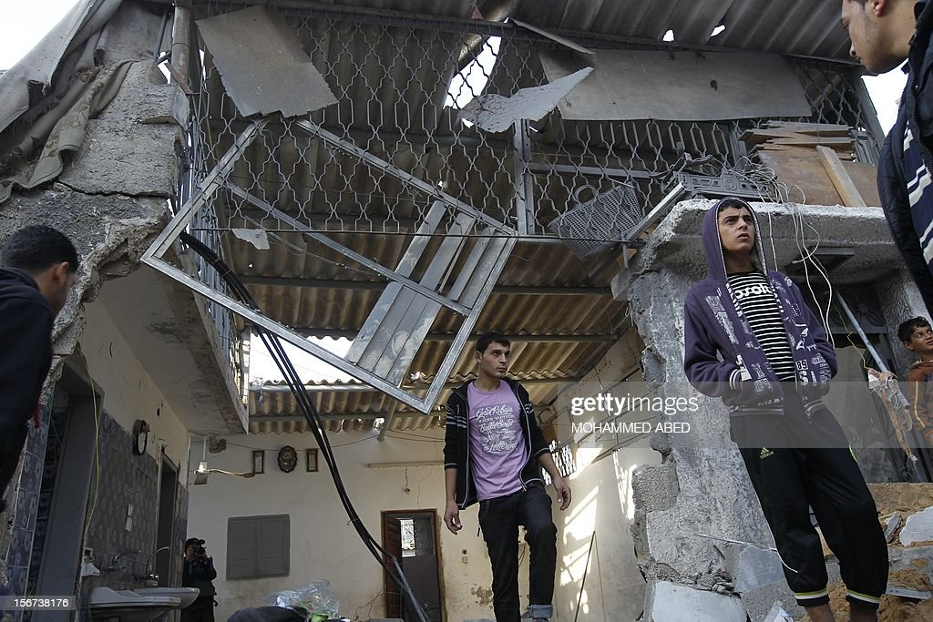 Palestinians look at the destroyed house of the Hejazi family hit during an Israeli air strike in Beit Lahia, in the northern Gaza Strip on November 20, 2012, killing several members of the same family, the Hamas Health Ministry said.
