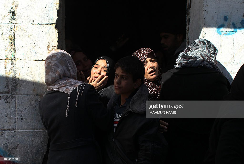 Palestinians mourn during the funeral of six members of the Dheir family who were killed after a fire swept through their house in Gaza City on January 31, 2013. Hazem Dheir, his wife Sahar and their four young children were killed in the fire that is believed to have started by an electrical fault. AFP PHOTO / MAHMUD HAMS