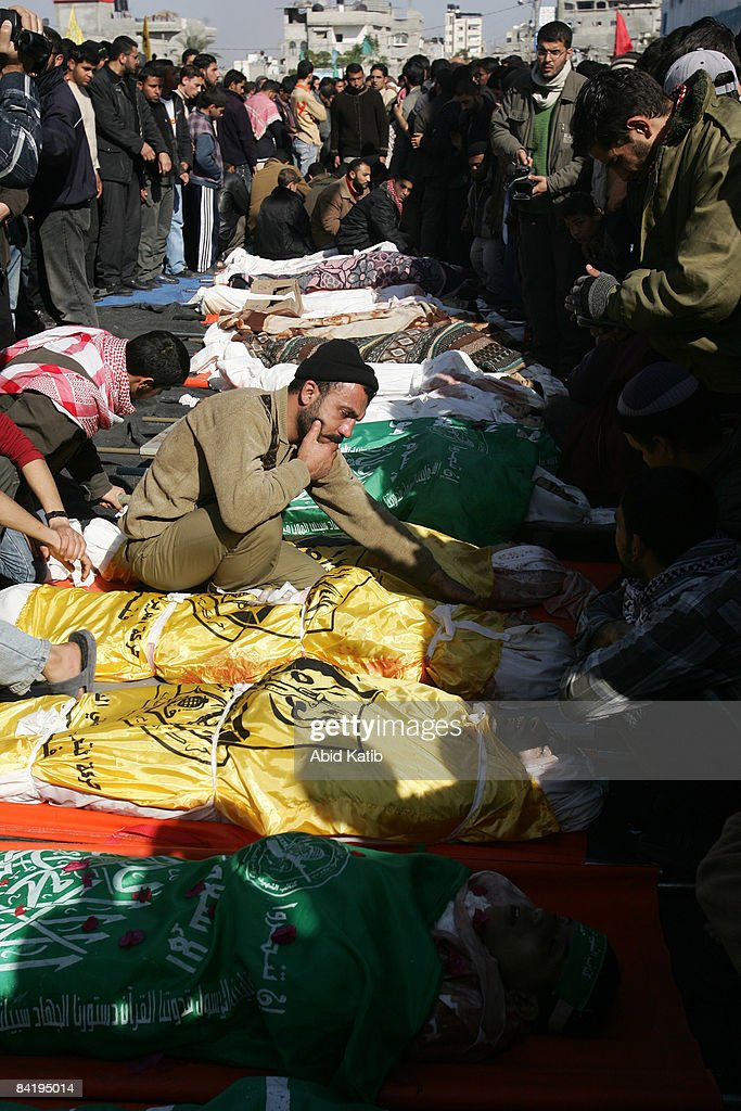 Palestinians mourn over the bodies of 42 people who were killed yesterday in an Israeli attack on a UNrun school building on Janaury 7 2009 in...