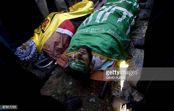 Palestinians mourn over the bodies of Mohammed and Salah Qawariq during their funeral procession on the outskirts of the West Bank city of Nablus on...