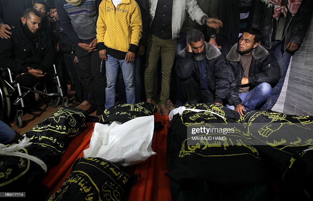 Palestinians mourn over the bodies of six members of the Dheir family after a fire swept through their house in Gaza City on January 31, 2013. Hazem Dheir, his wife Sahar and their four young children were killed in the fire that is believed to have started by an electrical fault. AFP PHOTO / MAHMUD HAMS