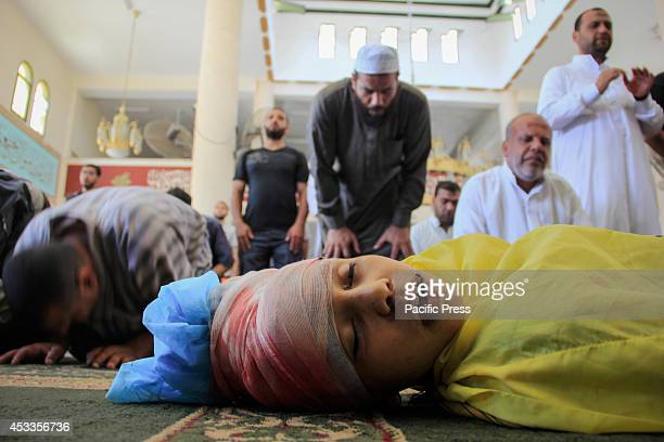 Palestinians mourn over the death of a ten year old boy Aldoawsh Ibrahim who was killed in an Israeli air raid on the Sheikh Radwan neighborhood in...