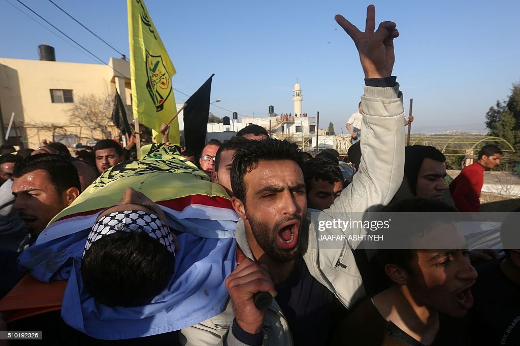 Palestinians mourners carry the bodies of teenagers Nihad Waked and Fuad Waked after they were shot dead by Israeli security forces as they reported fired on Israeli soldiers on February 14, 2016 during their funeral in the village of Araka, West of Jenin in the Israeli occupied West Bank. An Israeli army statement said the two teenagers attacked an Israeli patrol west of the city of Jenin with rocks before firing on soldiers with a rifle. 'The force responded to the shooting and fired towards the attackers, resulting in their deaths,' it said. The Palestinian health ministry named those killed as Nihad Waked and Fuad Waked, both 15 years old. They were not thought to be closely related. ASHTIYEH
