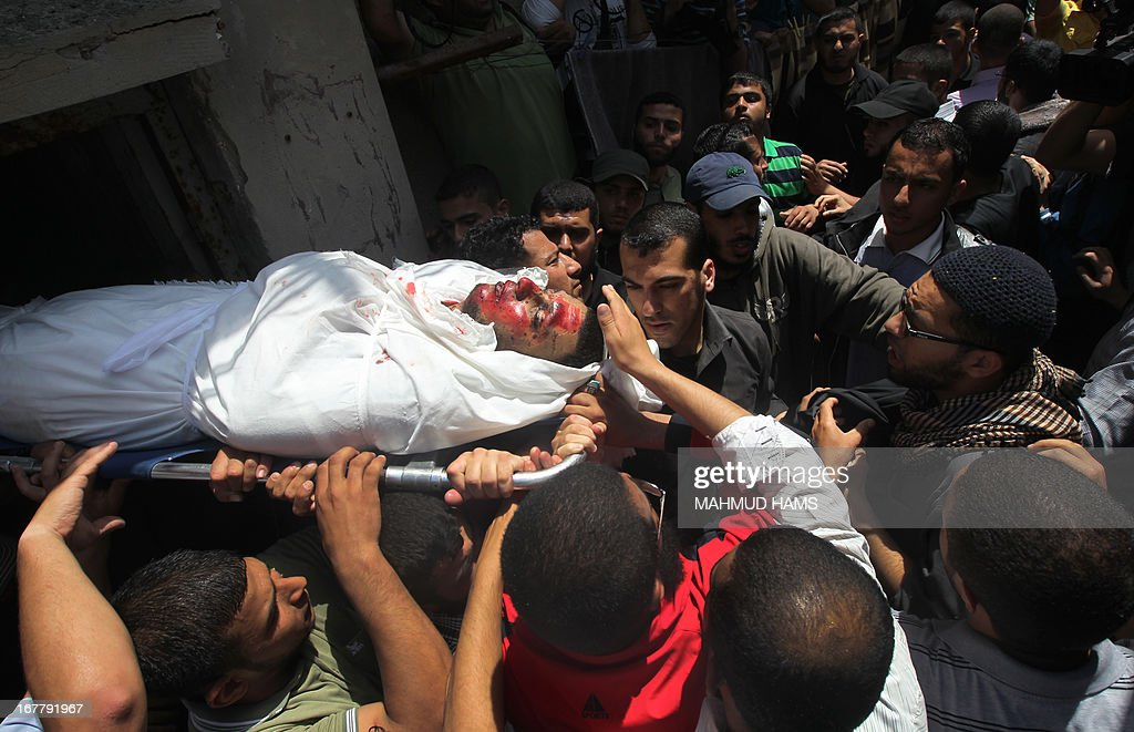 Palestinians mourners carry the body of Haitham Al-Meshal, during his funeral in Gaza City, on April 30, 2013. An Israeli air strike on Gaza City killed one person Palestinian officials said, with Israel saying it targeted a militant involved in a rocket attack on Eilat on April 17. AFP PHOTO/MAHMUD HAMS